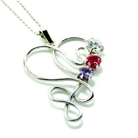 Ciondolo a forma di cuore stilizzato in argento con zirconi colorati